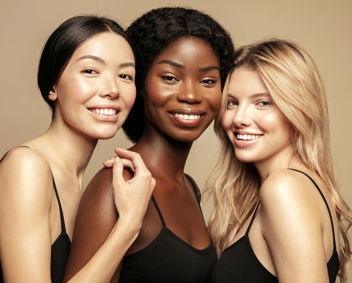 Three beautiful women with glowing skin, nails and hair