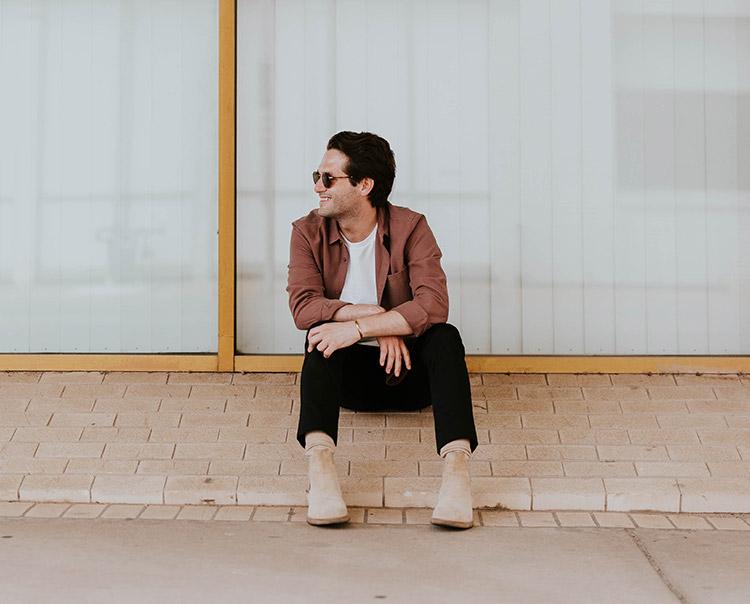 Man sitting on bricks